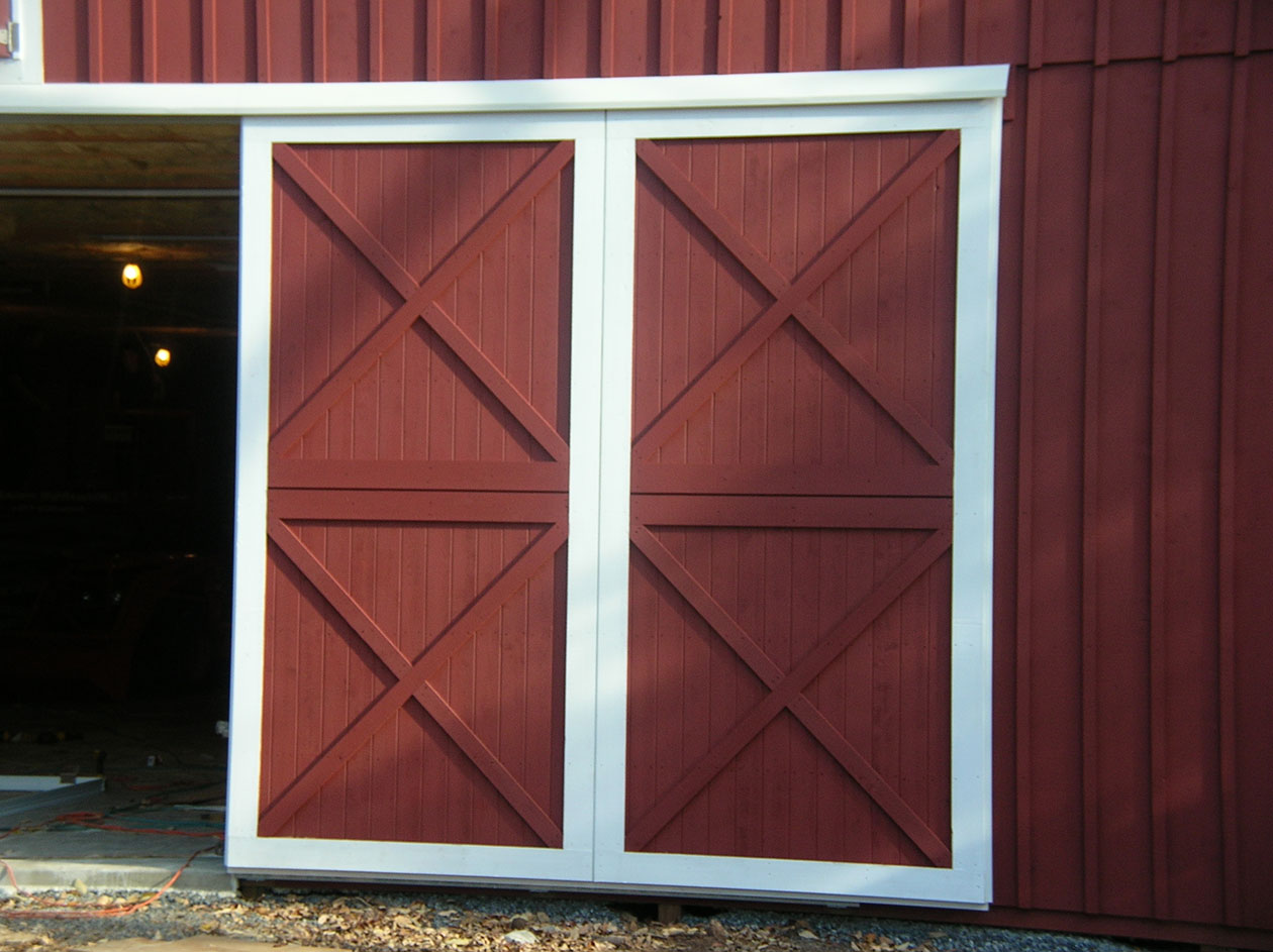 red pole barn door & Post Frame Building Door Options - Conestoga Buildings