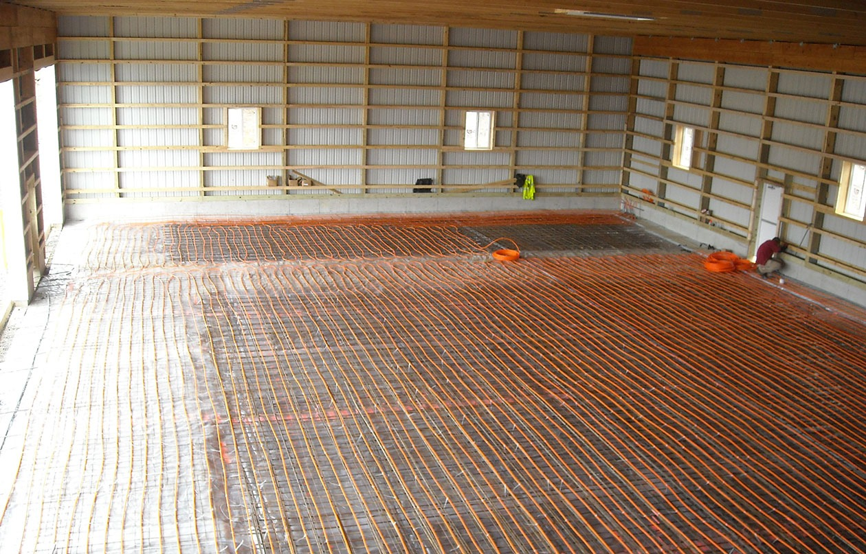 Post frame pole barn building options conestoga buildings for Radiant heat flooring options