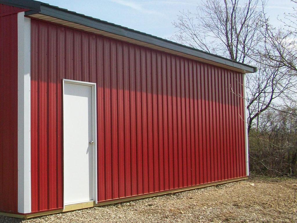 red siding on a pole building
