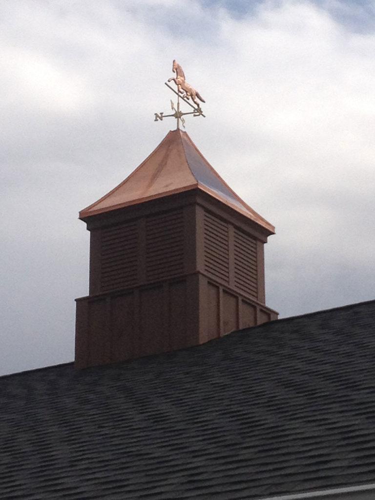 cupola and weather vane on pole barn