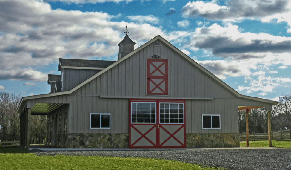 Building eaves onto your barn for extra storage for Building onto a house